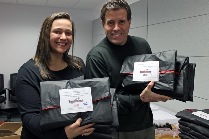 Fred and Kiana preparing to mail the Kickstarter rewards
