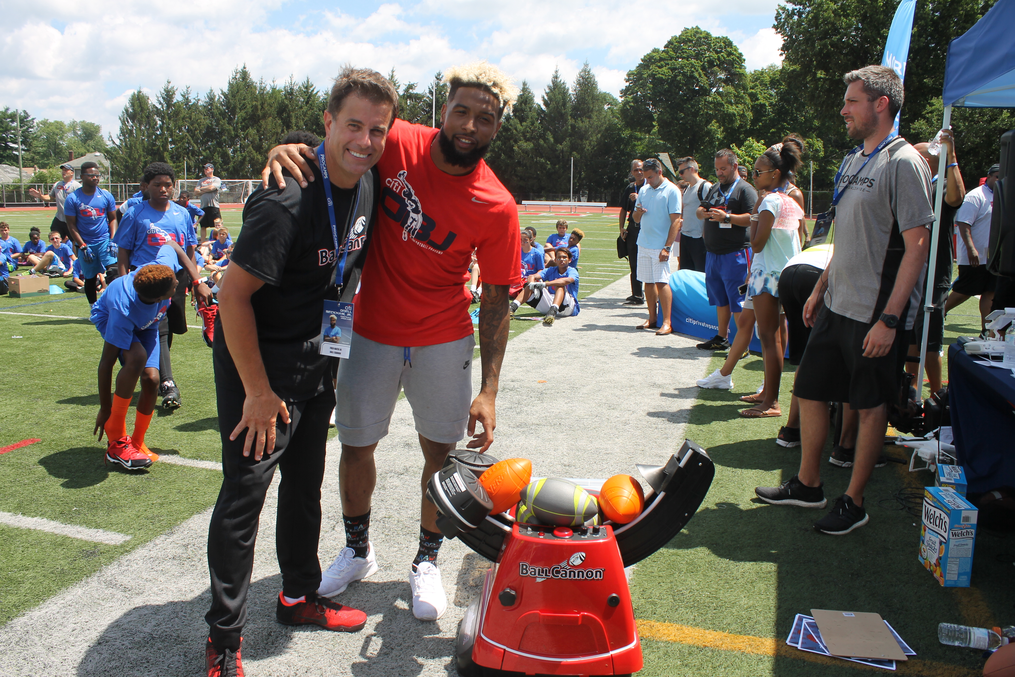 Fred Hafer, Jr. (President & CEO) and Odell Beckham, Jr. (NY Giants Wide Receiver) pose with the Ball Cannon at Boonton Highschool on July 26th, 2016.